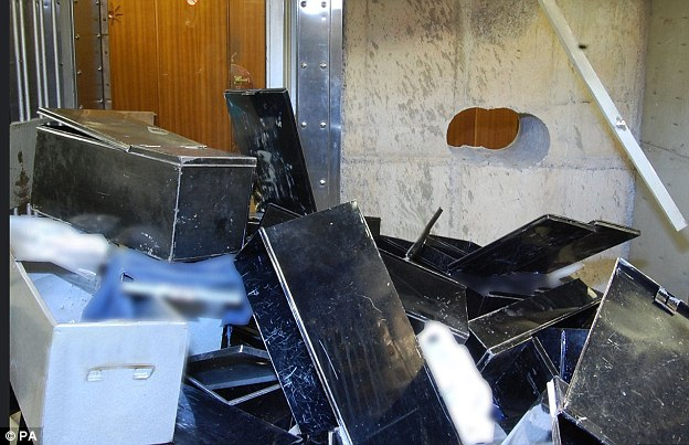 27DC164A00000578-3087852-The_safe_was_left_strewn_with_empty_safety_deposit_boxes_when_po-a-78_1432051612130