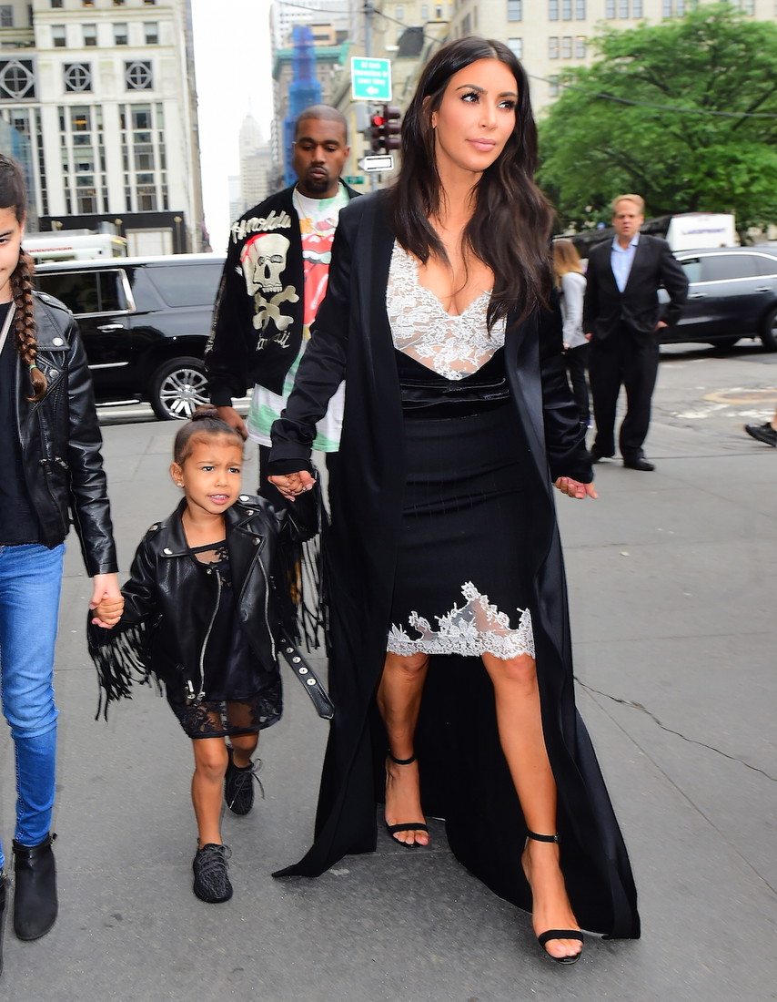 Kim Kardashian, Kanye West and adorable daughter North, were spotted grabbing Dinner in Midtown NYC after catching a matinee performance of The Lion King. The happy family headed to Cipriani's for dinner, enjoying a break from the stormy NYC weather that cancelled Kanye's performance. They enjoyed some family time, as North swung back and forth while walking into the restaurant. Pictured: Kim Kardashian, Kanye West, North West Ref: SPL1296141  050616   Picture by: 247PAPS.TV / Splash News Splash News and Pictures Los Angeles:310-821-2666 New York:212-619-2666 London:870-934-2666 photodesk@splashnews.com