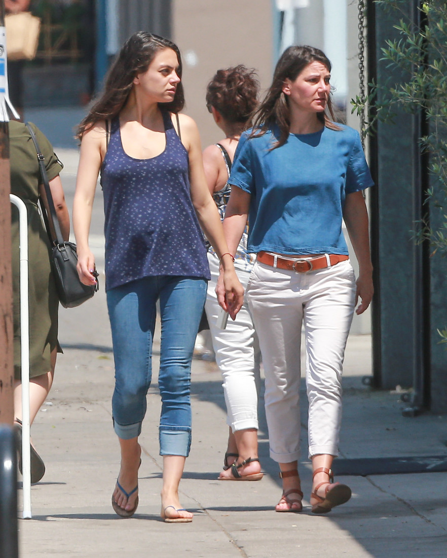 52100000 Pregnant actress Mila Kunis out grabbing lunch with a friend in Los Angeles, California on June 21, 2016. The two went to Cafe Gratitude. Mila's pregnant belly was starting to show in her blue shirt. FameFlynet, Inc - Beverly Hills, CA, USA - +1 (310) 505-9876