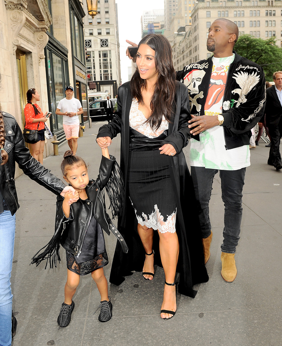 Kim Kardashian and Kanye West take daughter North West for lunch after watching 'Lion King' on Broadway in NYC. North was giggling and jumping around as they walked. She was wearing her baby custom yeezys. Pictured: Kim Kardashian and Kanye West Ref: SPL1296071  050616   Picture by: Splash News Splash News and Pictures Los Angeles:310-821-2666 New York:212-619-2666 London:870-934-2666 photodesk@splashnews.com