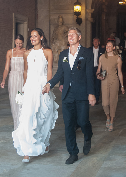 VENICE, ITALY - JULY 12:  Bastian Schweinsteiger and Ana Ivanovic followed by Miroslava Najdanovski (L) come out of the wedding hall at Palazzo Cavalli after the celebration of their marriage on July 12, 2016 in Venice, Italy.  (Photo by Awakening/Getty Images)