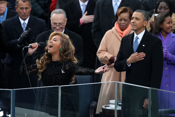 WASHINGTON, DC - JANUARY 21:  Beyonc? performs the national anthem as U.S. President Barack Obama looks on during the presidential inauguration on the West Front of the U.S. Capitol January 21, 2013 in Washington, DC.   Barack Obama was re-elected for a second term as President of the United States.  (Photo by Alex Wong/Getty Images)
