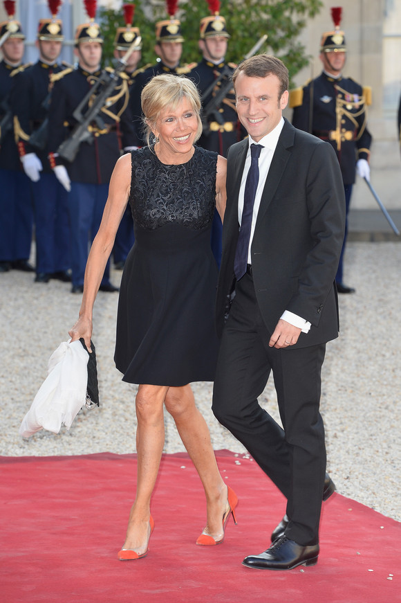 PARIS, FRANCE - JUNE 02: French Minister of Economy Emmanuel Macron (R) and wife Brigitte Trogneux arrive for the State Dinner Offered By French President Fran?ois Hollande at the Elysee Palace on June 2, 2015 in Paris, France. (Photo by Pascal Le Segretain/Getty Images)