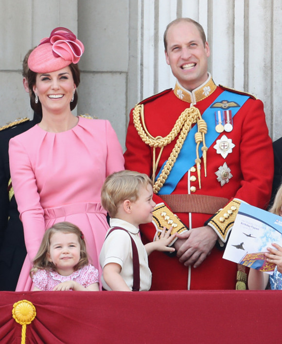 LONDON, ENGLAND - JUNE 17: (L-R) Catherine, Duchess of Cambridge, Princess Charlotte of Cambridge, Prince George of Cambridge and Prince William, Duke of Cambridge look out from the balcony of Buckingham Palace during the Trooping the Colour parade on June 17, 2017 in London, England. (Photo by Chris Jackson/Getty Images)