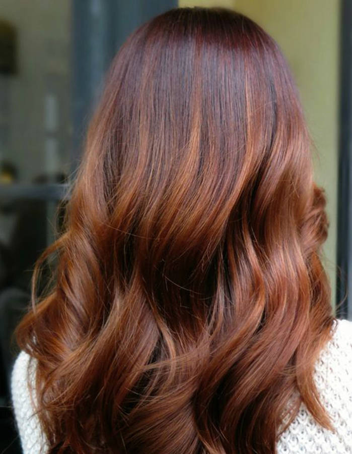 Balayage-cuivre-sur-cheveux-noirs
