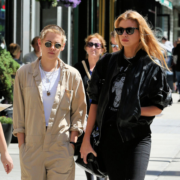 Actress Kristen Stewart, wearing a brown jumpsuit, and model Stella Maxwell head to lunch in Little Italy in New York City, New York