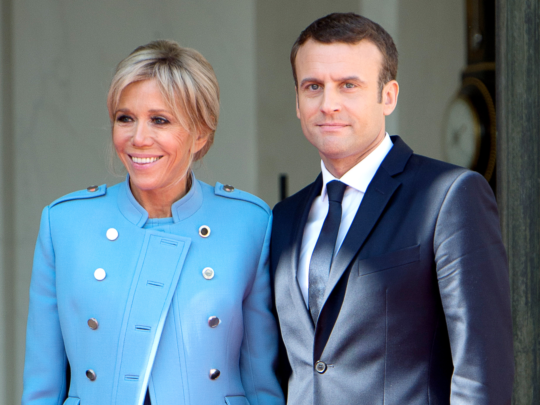PARIS, FRANCE - MAY 14: French newly elected President Emmanuel Macron poses with his Wife Brigitte Macron at the Elysee presidential Palace after the handover ceremony with his predecessor Francois Hollande at Elysee Palace on May 14, 2017 in Paris, France. Emmanuel Macron was elected President of the French Republic on May 07, 2017 with 66,1 % of the votes cast at Elysee Palace on May 14, 2017 in Paris, France. (Photo by Thierry Orban/Getty Images)