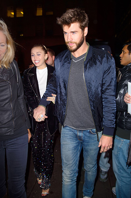 Liam Hemsworth and Miley Cyrus arrive at the SNL after party in New York